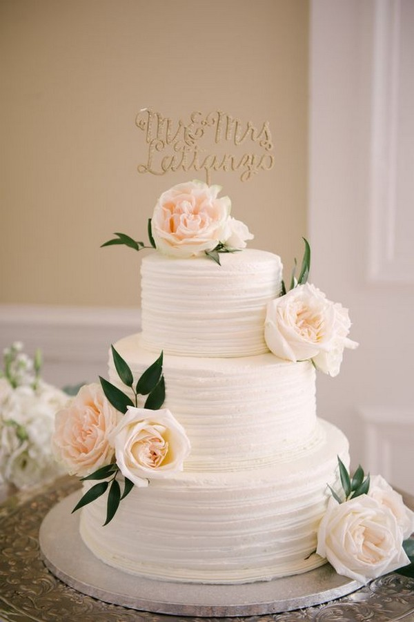 simple elegant tree tiered wedding cake with neutral florals