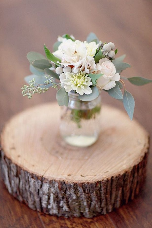 simple wedding centerpiece with tree stump