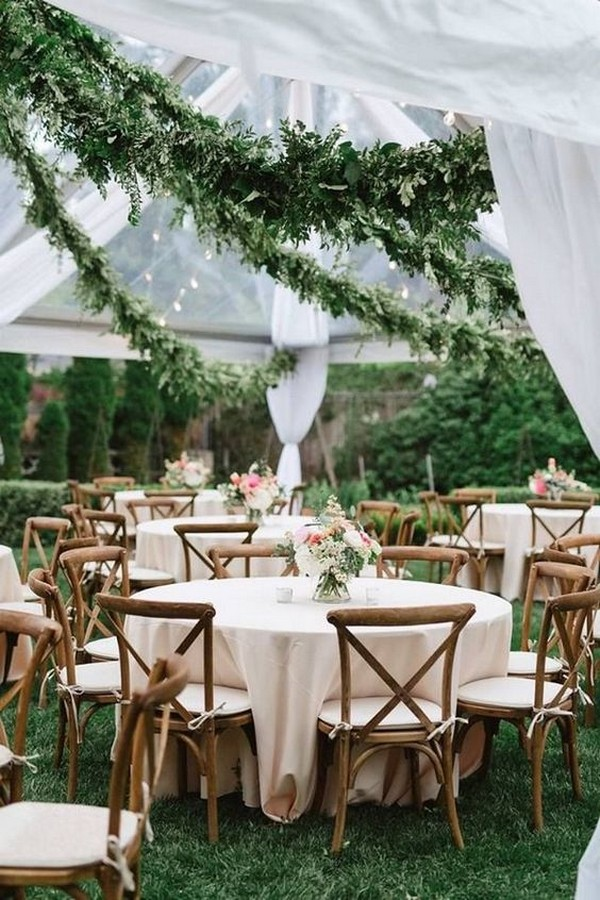 tented wedding ideas with hanging greenery garlands