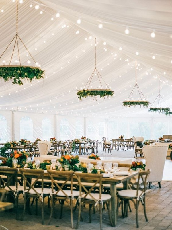 tented wedding reception ideas with hanging greenery chandelier