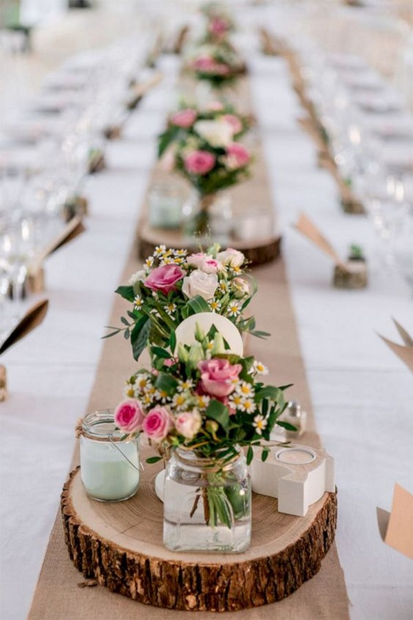 wedding centerpiece ideas for long table with tree stumps