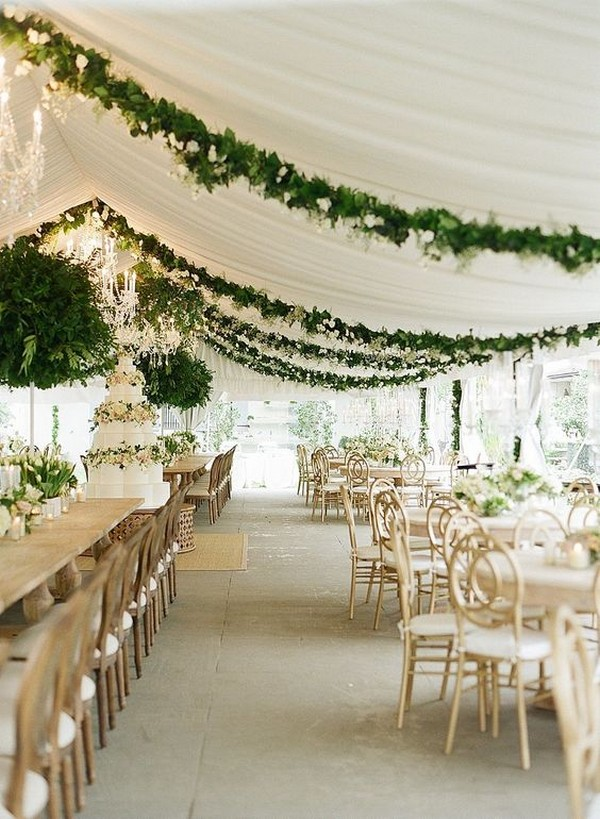 white tent wedding reception ideas with greenery decorations