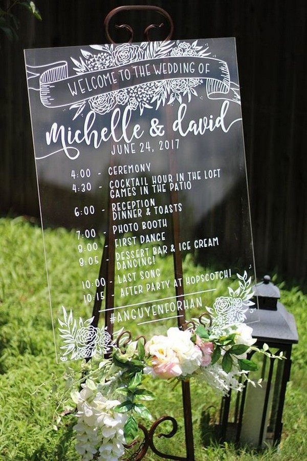 acrylic wedding welcome sign with a timeline of the day