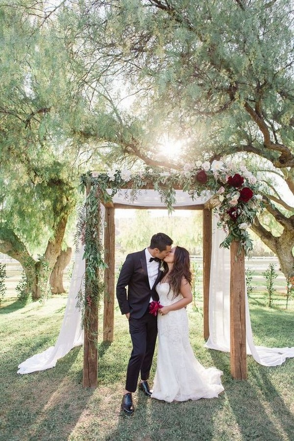 burgundy and greenery fall wedding arch ideas