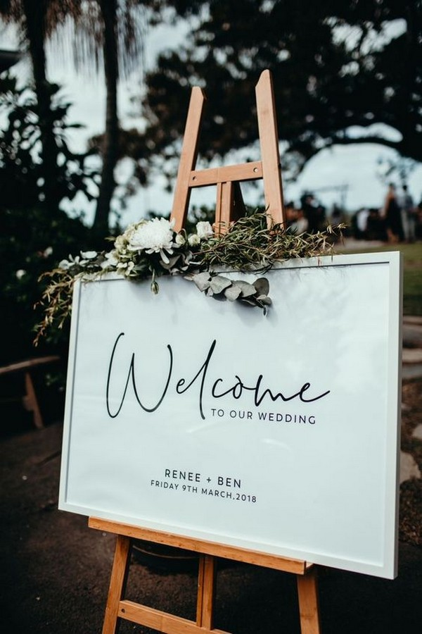 chic simple white greenery and black wedding welcome sign
