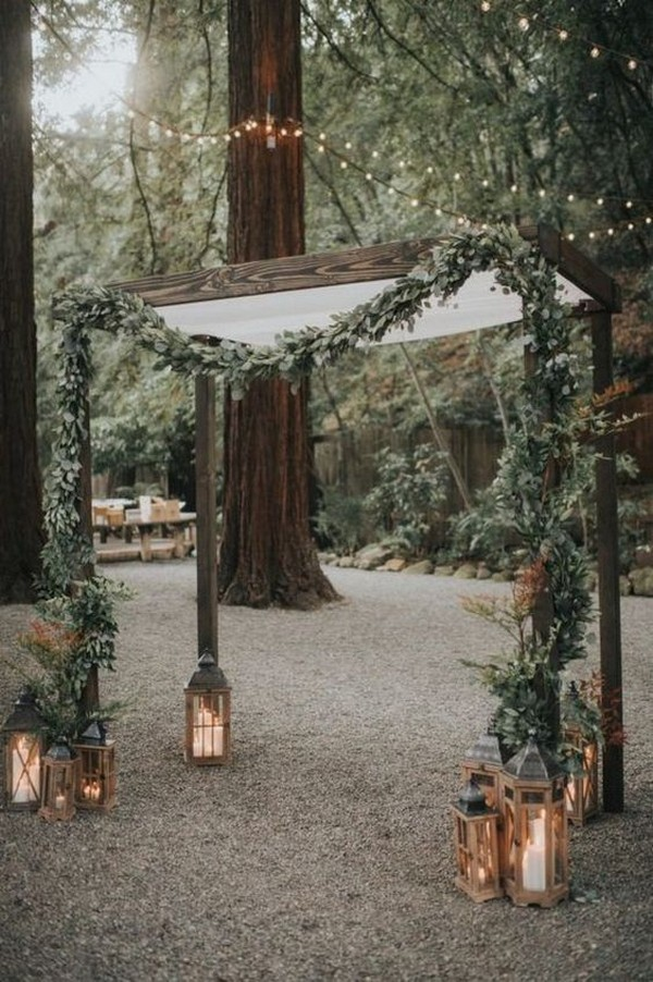 fall greenery wedding arch ideas with lanterns