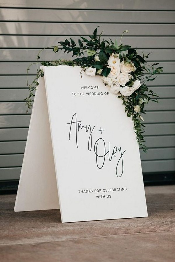 minimalistic white greenery and black wedding sign