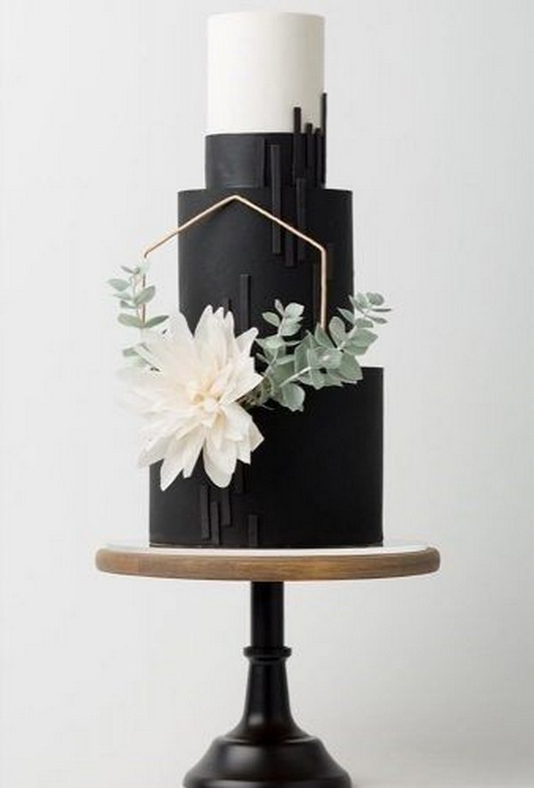 modern black and white wedding cake with floral