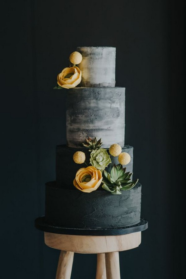 modern black wedding cake with succulents and floral