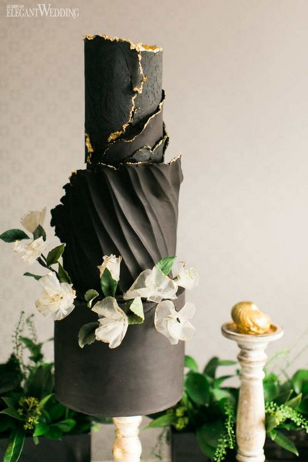 modern ruffled black wedding cake with gold and white