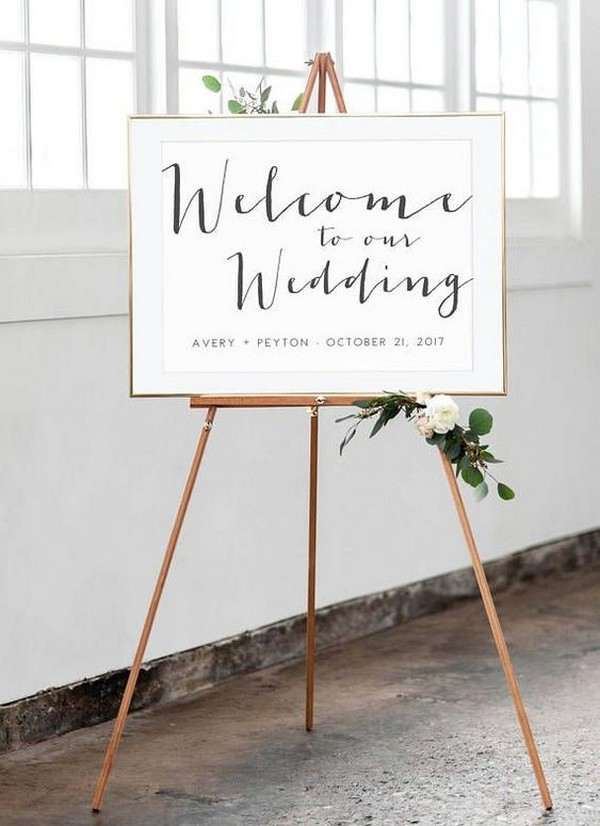 modern wedding welcome sign with copper stand
