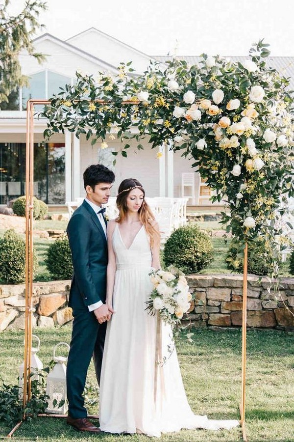 outdoor copper wedding arch with floral