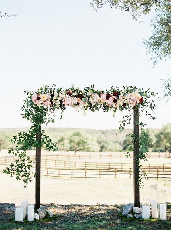 outdoor fall floral wedding ceremony arch
