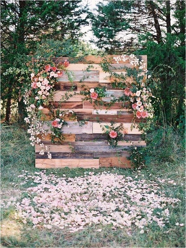 outdoor rustic wedding backdrop with wooden pallets and floral