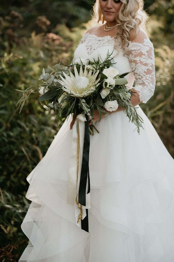 wedding bouquet with black and gold ribbon