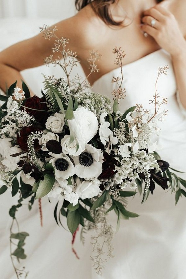 white and greenery wedding bouquet with black