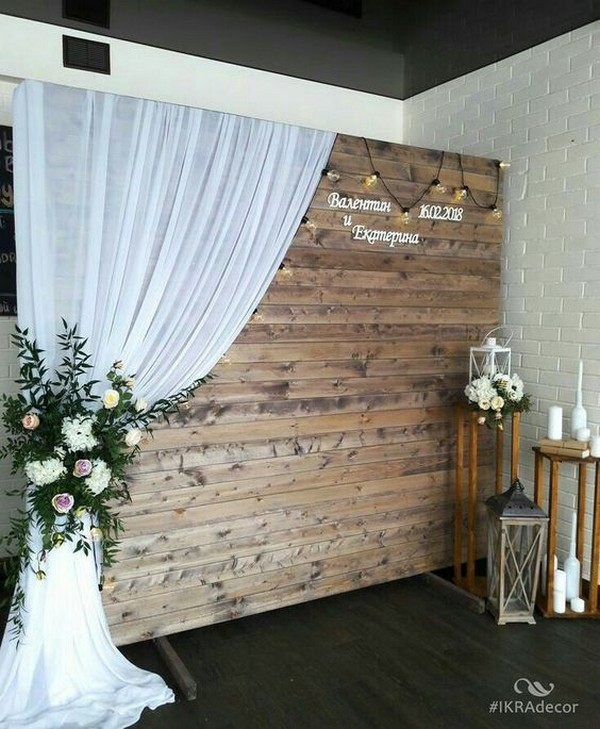 creative wooden wedding photo booth with white drapery