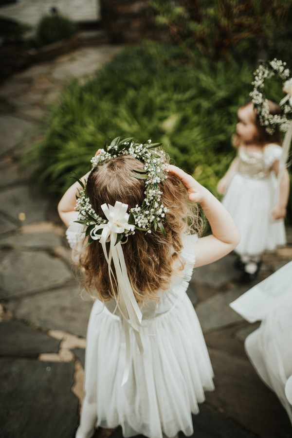 cute flower girl in baby's breath and white dress