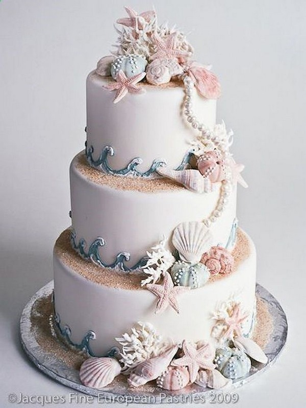 pink and blue sea shells beach wedding cake