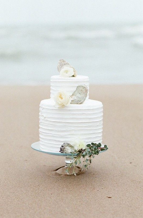 simple beach wedding cake with shell toppers
