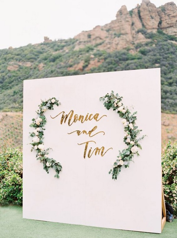 white and greenery chic outdoor wedding photo booth