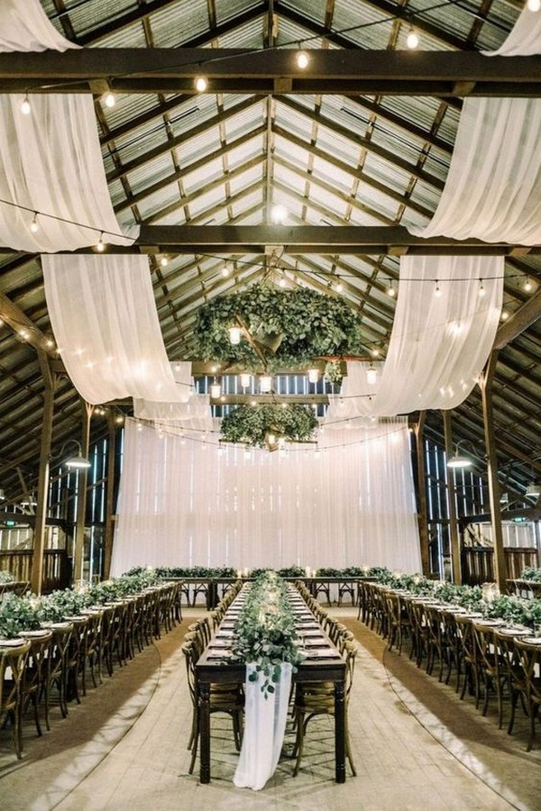 chic barn wedding reception ideas with white drapery and greenery