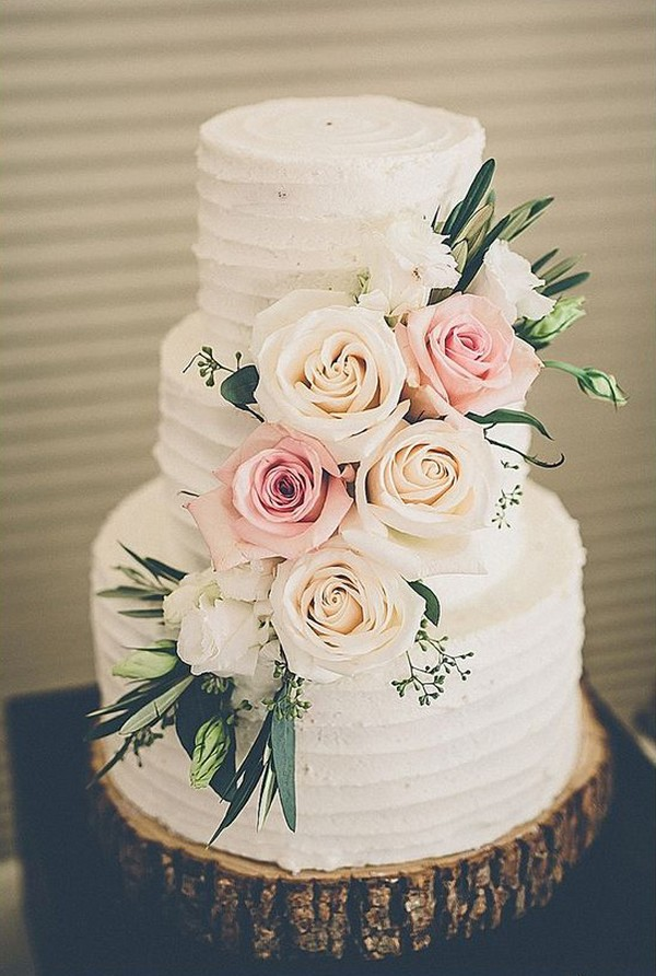 chic rustic wedding cake with flowers and tree stump stand