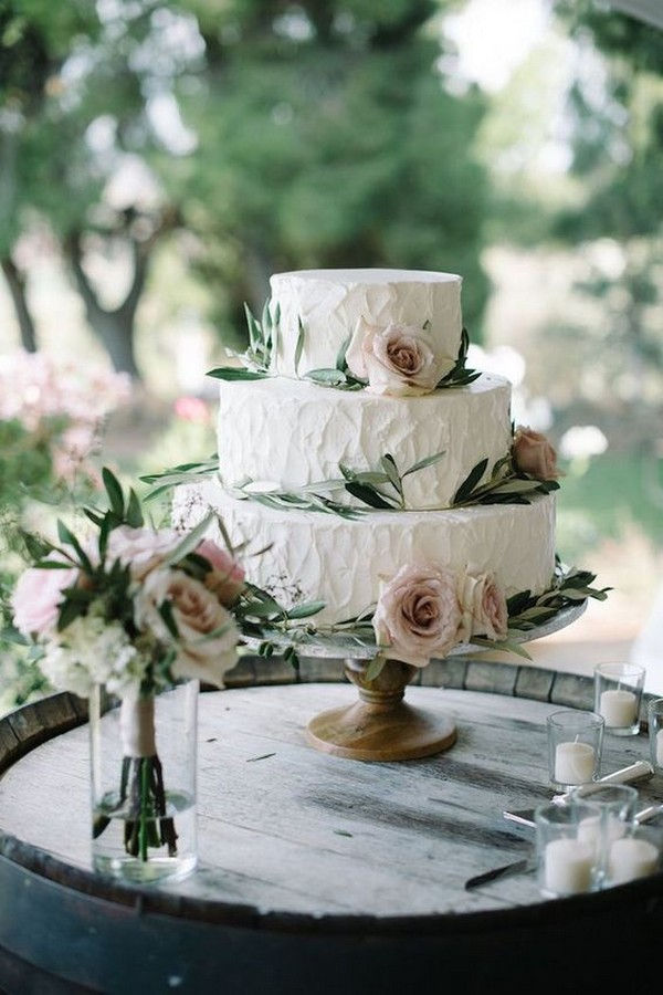 chic rustic wedding cake with greenery and roses