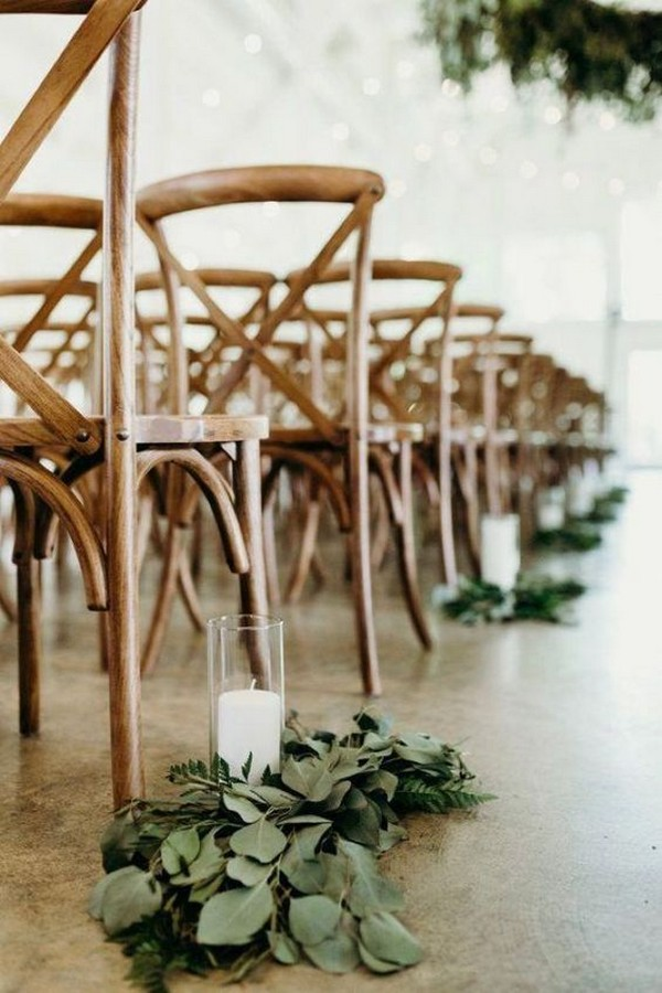 chic wedding aisle ideas with candles and greenery