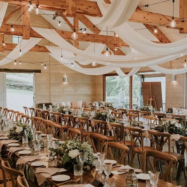 country barn wedding decorations with white draping