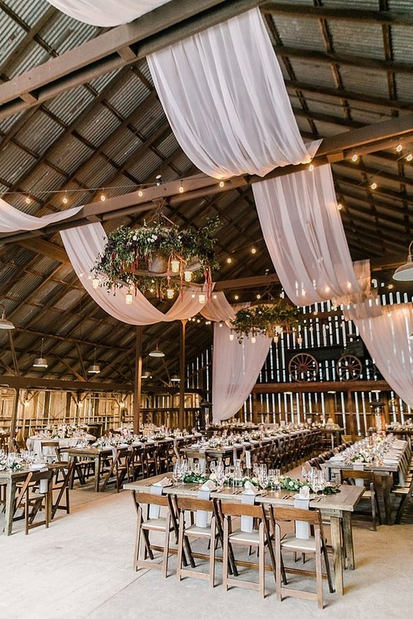 country barn wedding reception with draping decorations