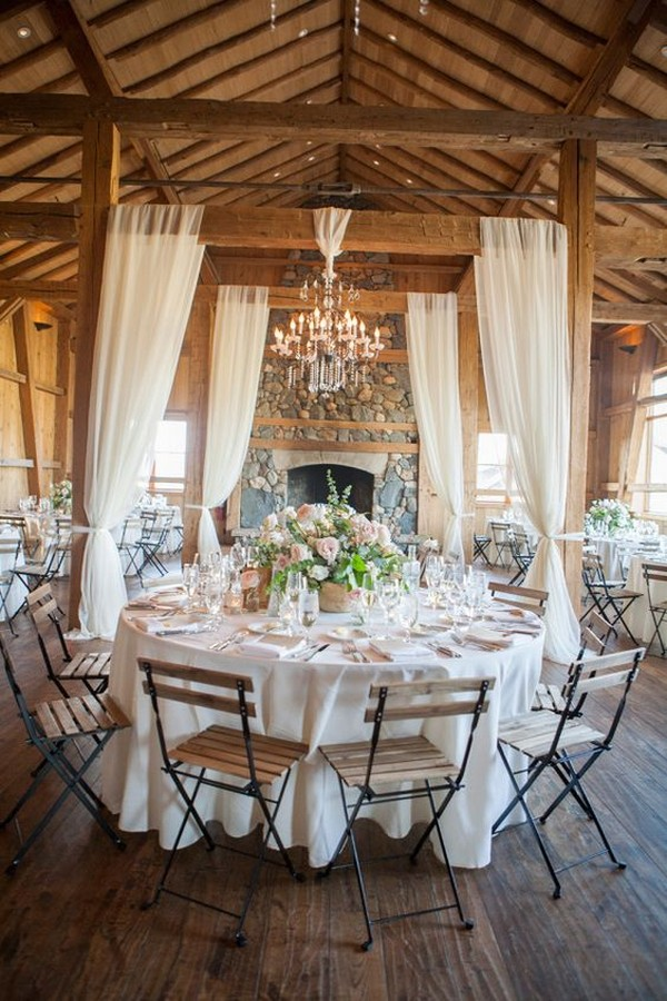 country barn wedding reception with white draping