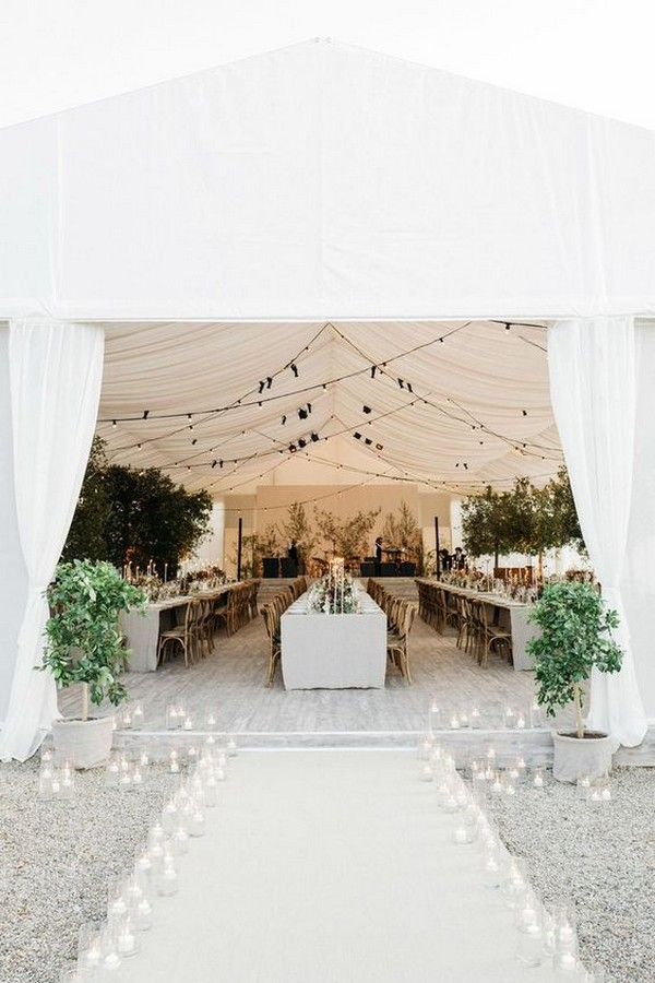 elegant tent wedding reception entrance with candle lights