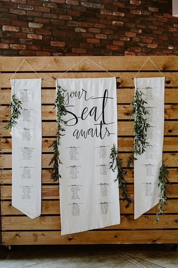 hanging wedding seating arrangement with greenery