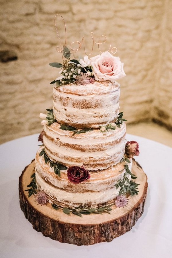 naked rustic wedding cake with tree stump stand