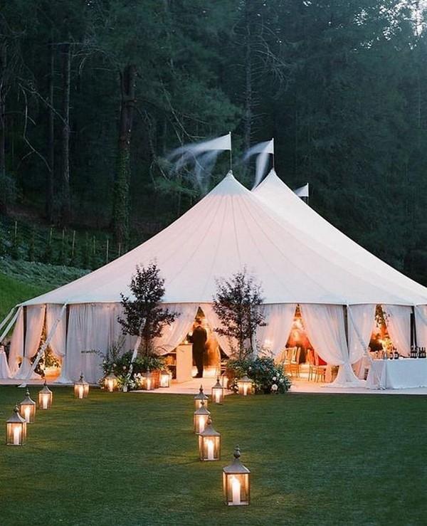 outdoor wedding entrance for night tented wedding