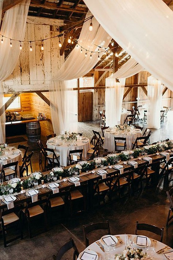 rustic barn wedding reception with white drapery