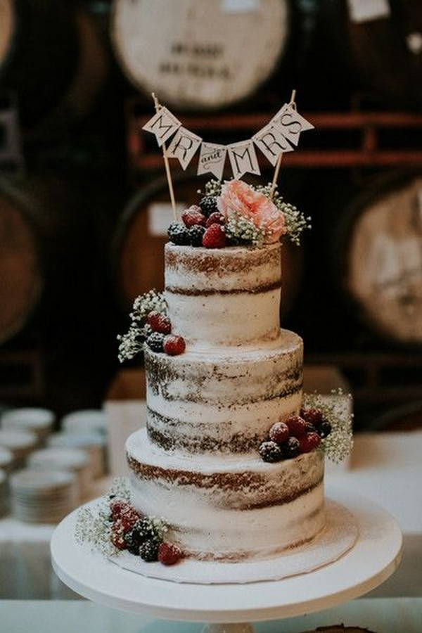 rustic wedding cake with fruits and baby's breath