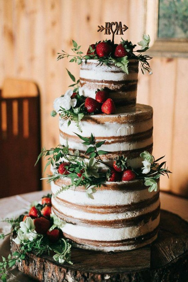 semi naked rustic wedding cake with strawberries