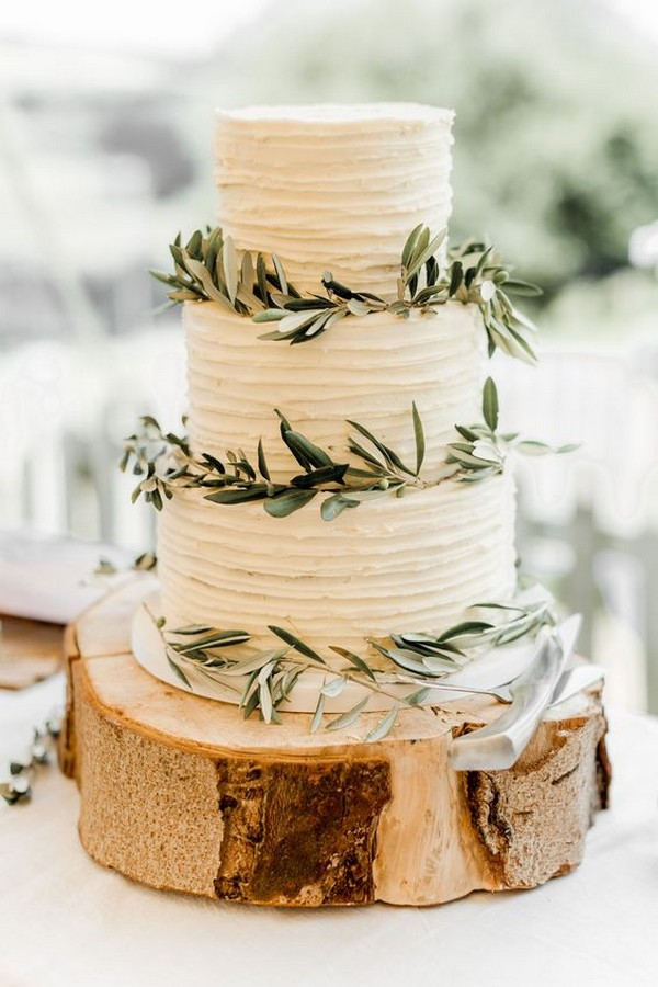 simple rustic wedding cake with olive leaves