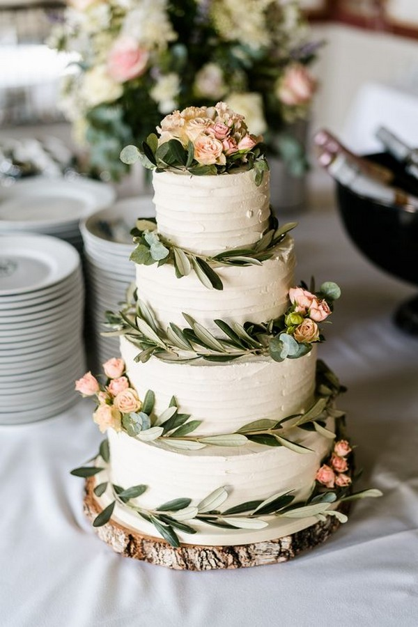 simple rustic wedding cake with tree stump stand