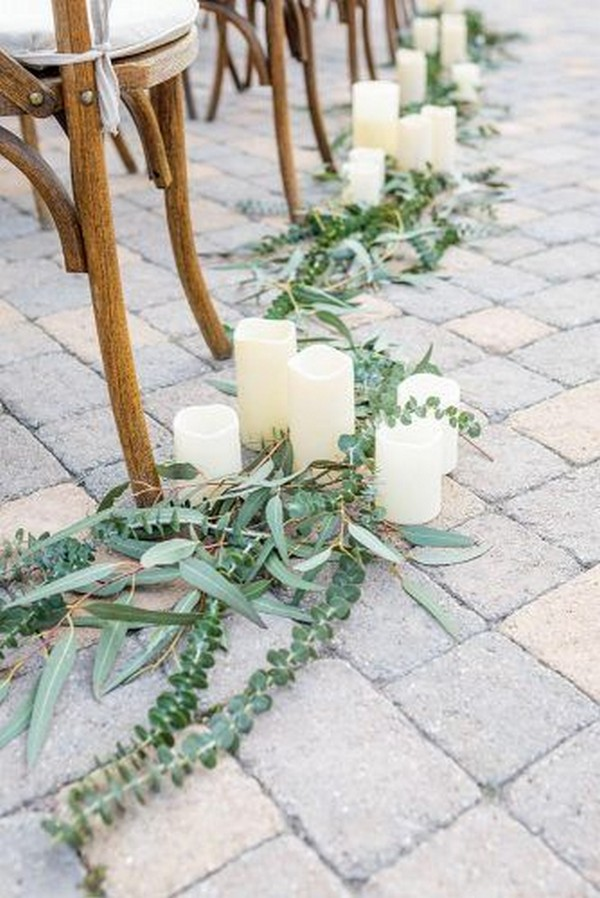simple wedding aisle ideas with candles and greenery