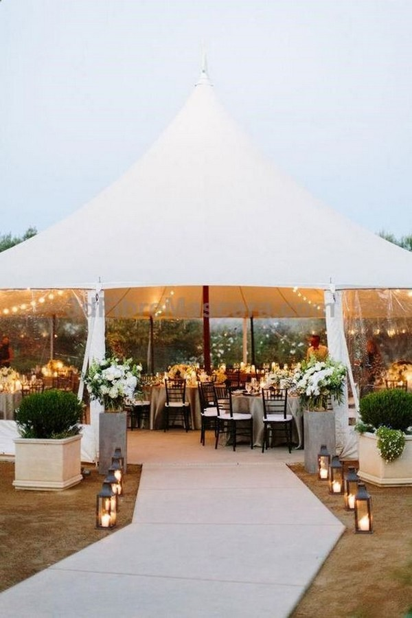 tented wedding reception entrance decorated with lanterns