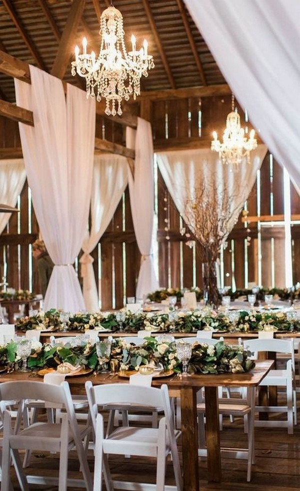 wedding reception with white draping in a barn
