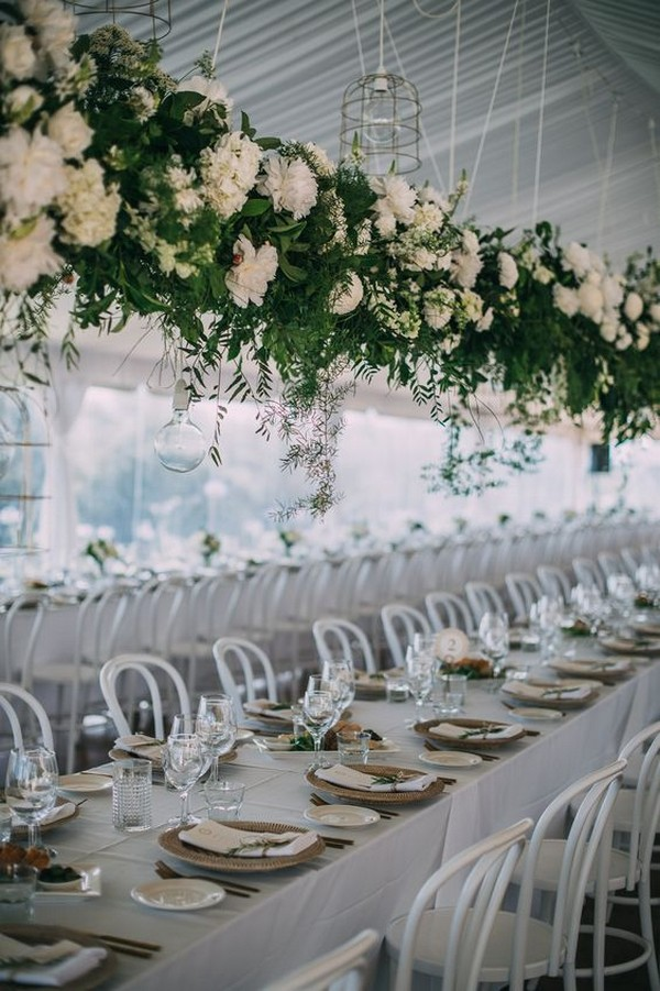 wedding tablescape with hanging white and green flowers