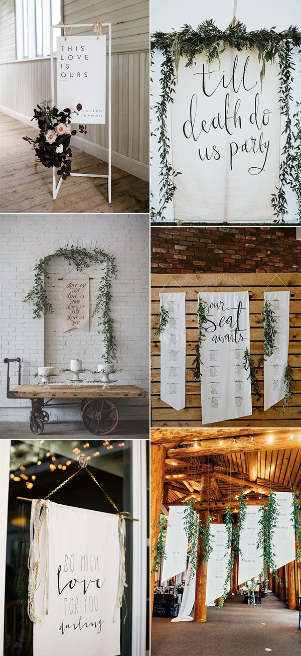 white and greenery hanging wedding signs