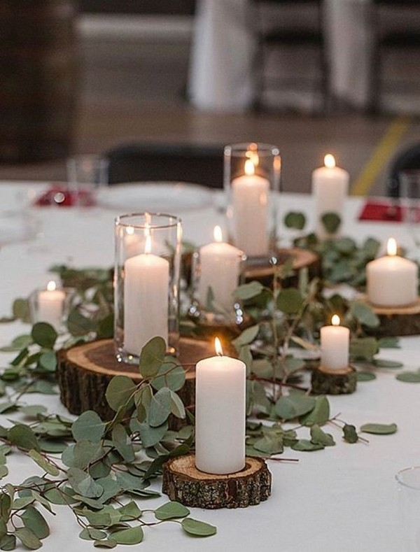 budget friendly wedding centerpiece with tree stumps candles and greenery