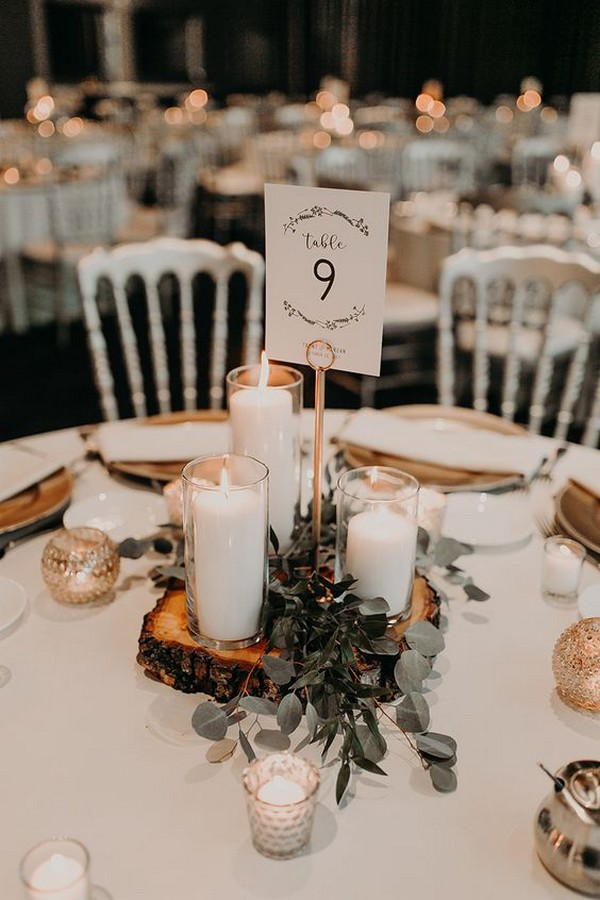 chic rustic wedding centerpiece ideas with candles greenery and tree stumps