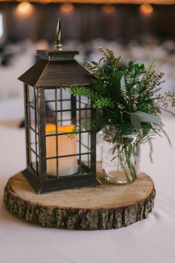 chic rustic wedding centerpiece with lantern and greenery
