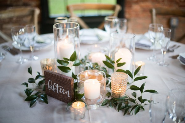 elegant budget friendly wedding centerpiece with candles